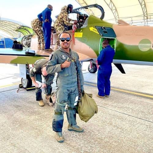 A Nigerian Air Force pilot poses with A-29 Super Tucano