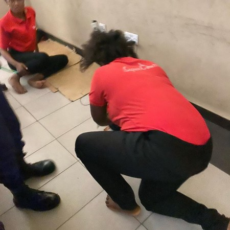Lagos State High Court Workers Filmed Sleeping Behind The Reception Desk During Work Hours (Video)