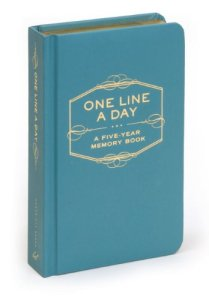 "A small teal book. Embossed on the cover are the words ""One Line a Day: A five year memory book."""