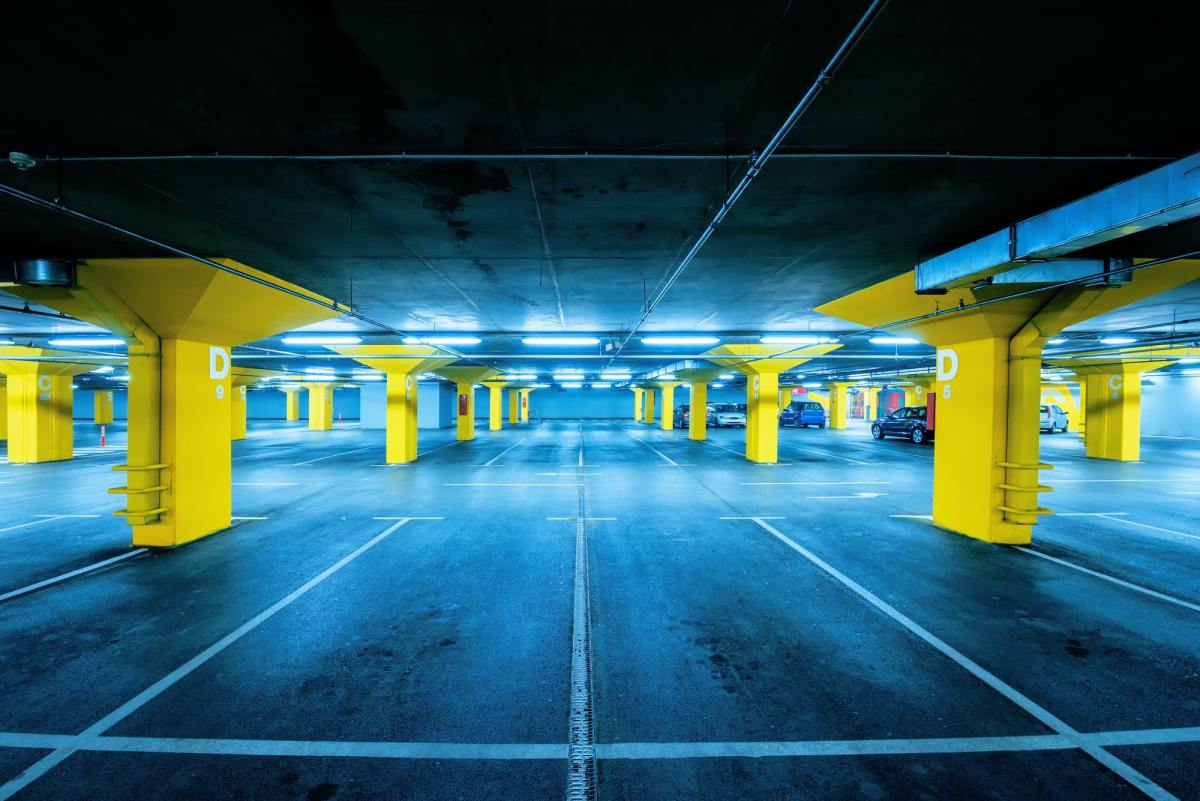 Underground garage parking lot with few cars and empty spaces
