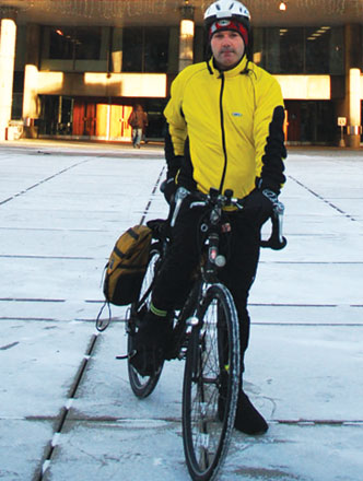 Glenn De Baeremaeker sits atop his bicycle