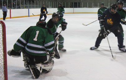 The Sir Oliver Mowat Gaels launch an attack on the John A. MacDonald Collegiate net during the Tier Two final. Mowat lost a hard-fought game 3-2.
