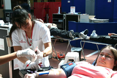 Jennifer Brethour (right) gives the gift of blood with the help of registered nurse Rita Dobson (left) Sept. 20 at the Malvern Town Centre.