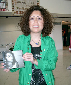 Sara Cavaiola proudly displays her new album, Lemonade Daze.