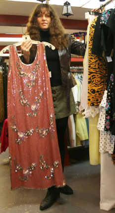 Sherri Lyn Higgins showcases her favourite flapper-style dress from the 70s in the store.