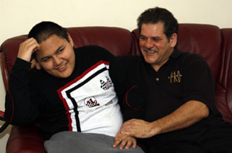 Stefan Marinoiu (right) says that he always wanted to do something for his 15-year-old son with autism, Simon (left) to get him a treatment.