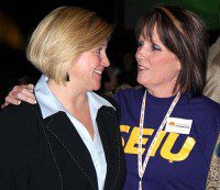 Andrea Horwath celebrates her Ontario NDP leadership win with Sharleen Stewart, president of the Service Employees International Union, following Horwath's victory tonight at the New Democrats' Hamilton convention. Horwath becomes the party's first female leader.