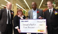 Walmart Supercenter Morningside Ave. donates $4,000 to the East Scarborough Boys and Girls Club as they celebrate their grand opening Feb. 27. (Courtesy Walmart Canada)