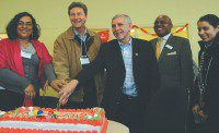TDSB trustee Nadia Bello, MP John McKay, Councillor Ron Moeser and Newcomer Services project administrator Bantu Mutenka cut a ceremonial cake at the open house for the new Kingston-Galloway centre for youth newcomer services. (Tevy Pilc/Toronto Observer)