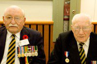 Second World War veterans proudly show off their medals. (Amanda Ly/Toronto Observer)