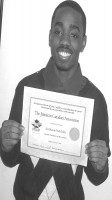 Nathaniel McLarty receives an award for his contribution in the Jamaican community. (Monica Valencia/Torotno Observer)