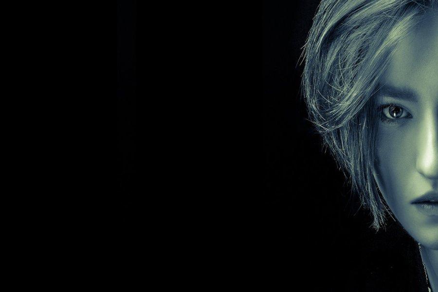 Half face portrait of female in sepia tone