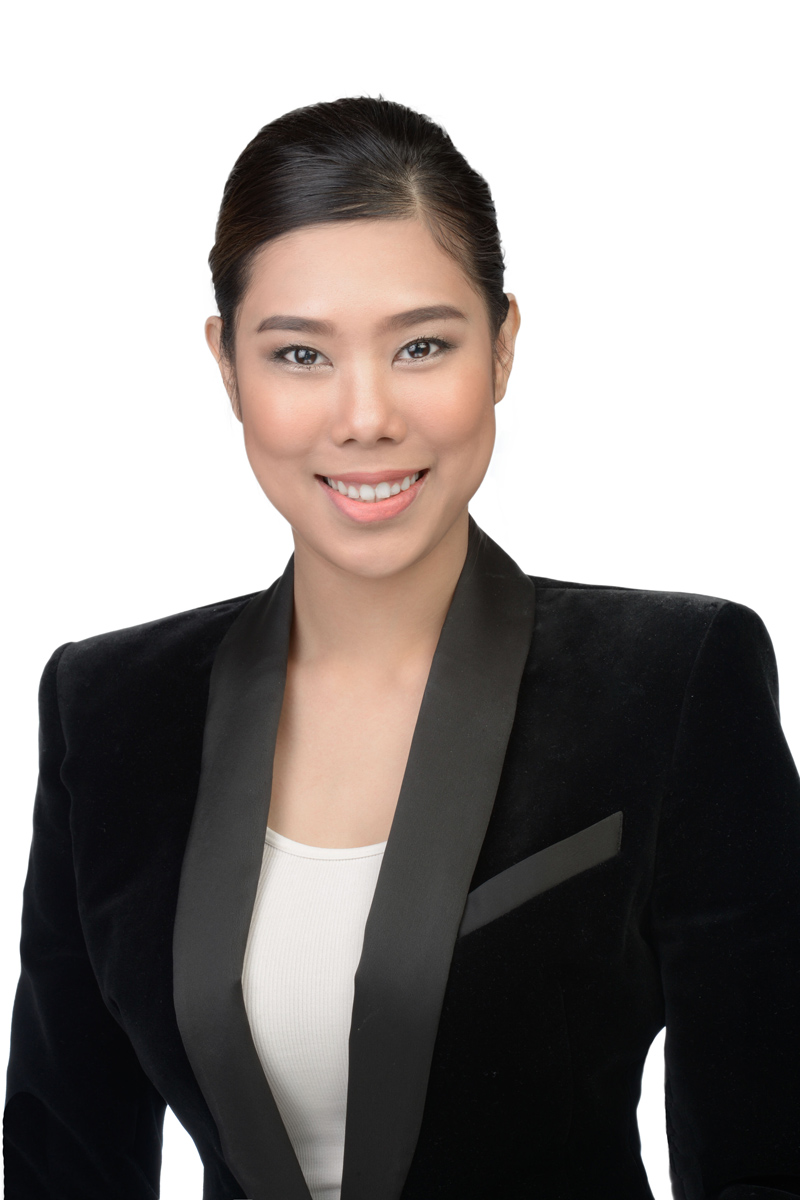 LinkedIn headshot of asian women with suite and white background