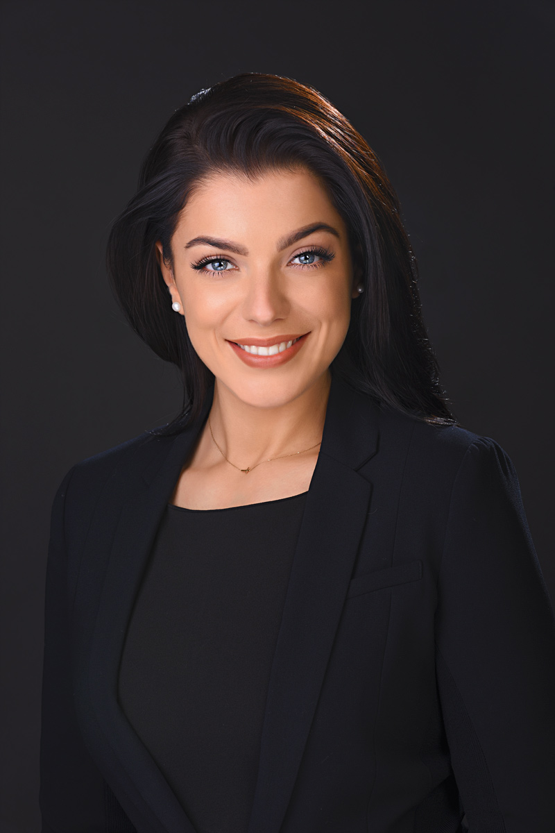 business headshot of women taken in portrait studio with black background