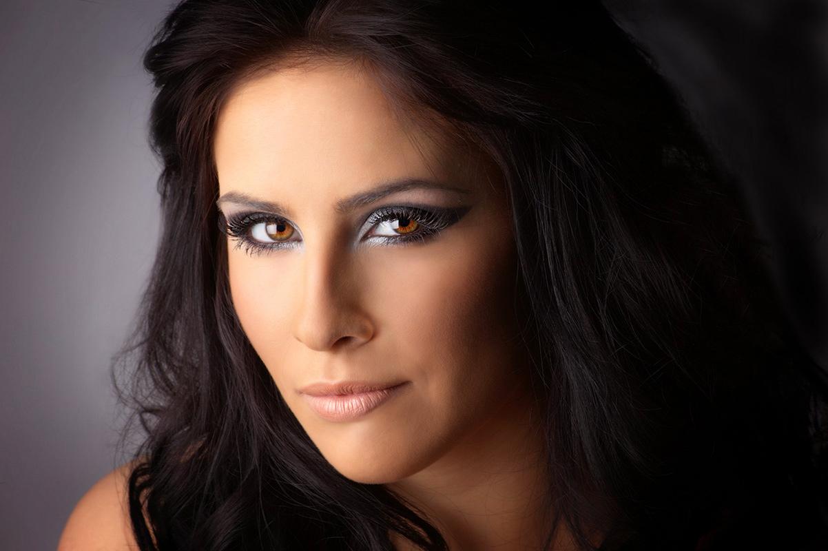 Headshot of women width strong eyes