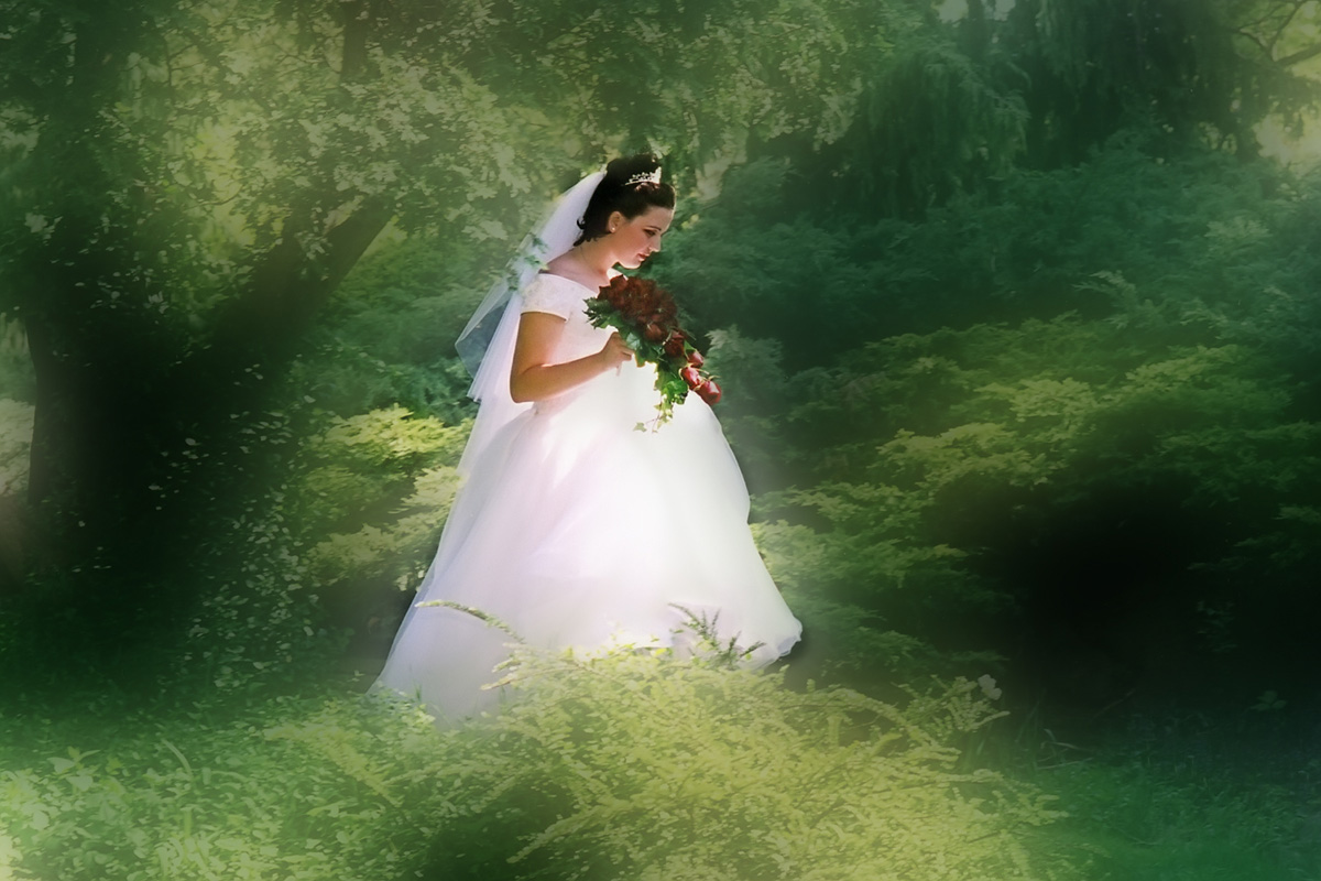 Bride waking in the woods