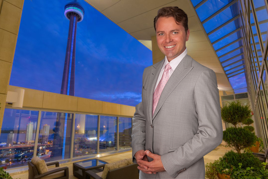 Personal branding photo of man with grey suit blue sky background with CN tower