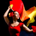 Flamenco dancer with red and yellow fans