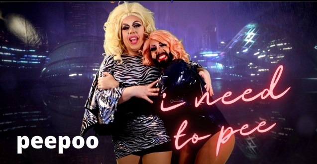 """""""Two drag queens stand and embrace in front of a purple city scape projection. Hillary Yaas wears a blond wig and a zebra print dress, while Selena Vyle wears a pink wig, their natural brunette beard, and a purple body suit. The text on the left side reads """"peepoo"""" in white, and the text on the right in pink reads """"I need to pee"""""""