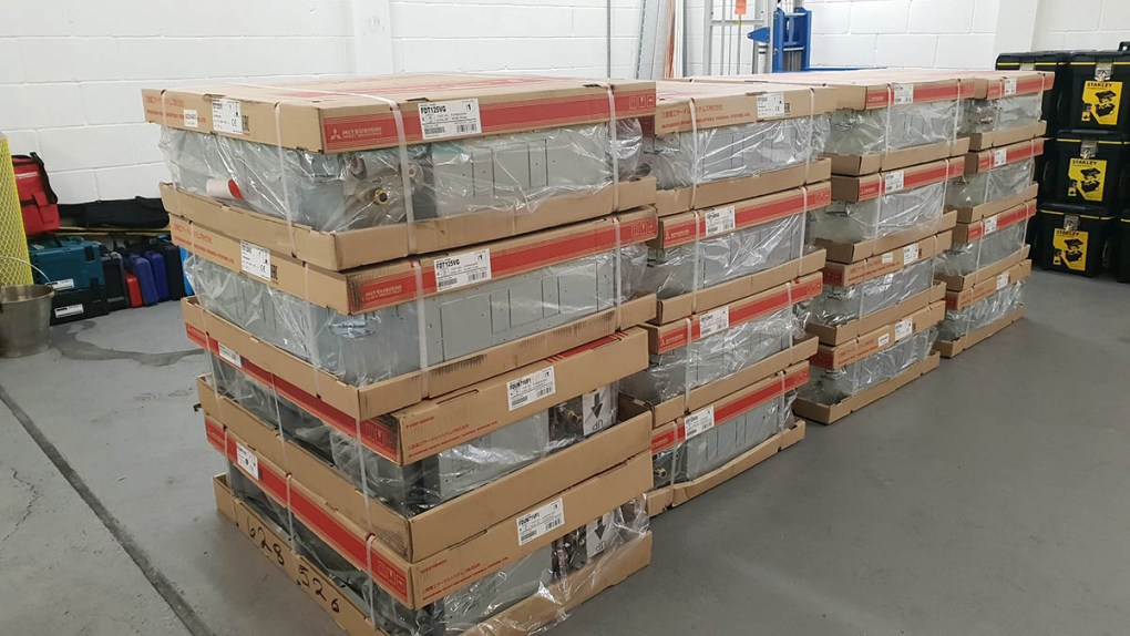 16 Mitsubishi Heavy Industries indoor fan coil units delivered and ready for unpacking in the electrical substation at VPI Immingham.