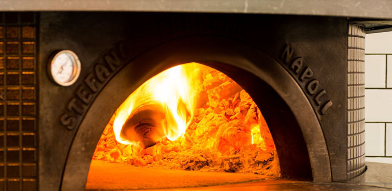 Tredici's wood fired pizza oven.