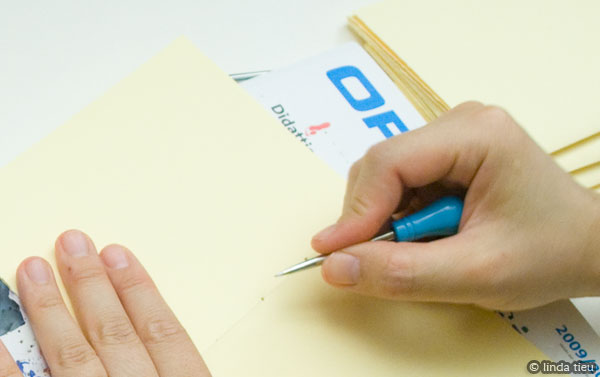 Punching holes in the paper signature
