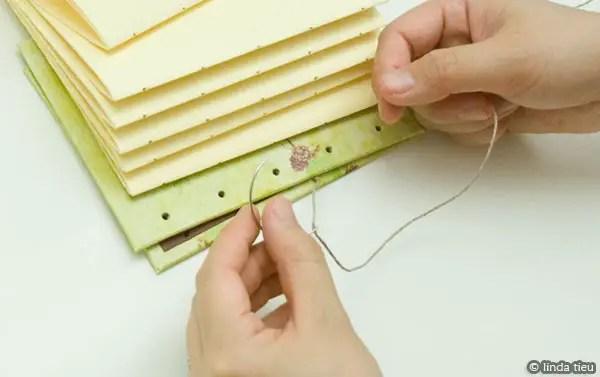 Sewing book using coptic stitch method