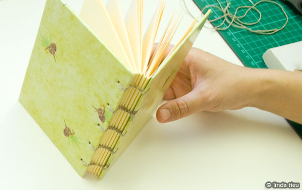 Completed book with coptic stitch bookbinding