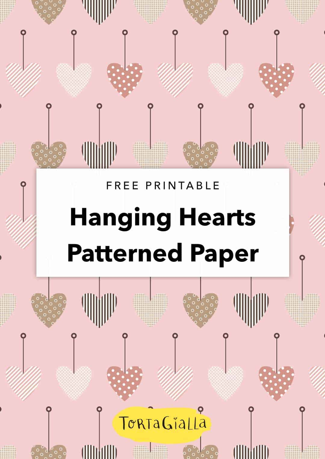 Looking for a pretty paper printable? Check out this free hanging hearts patterned paper design. Use it to decorate your planner, scrapbook and more!