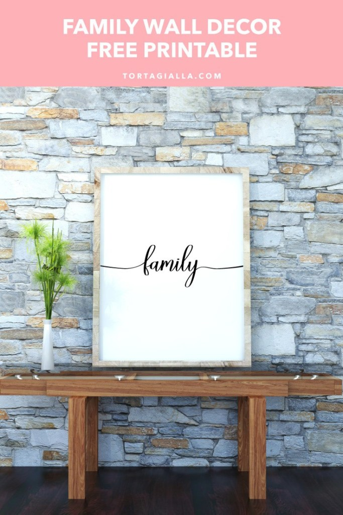 Family Wall Decor Free Printable in a frame on rustic rock wall, on top of a wooden table. For free download on tortagialla.com