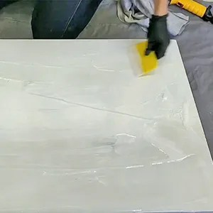 Epoxy Marble Effect Tutorial - Pour a flood coat of white mixed epoxy