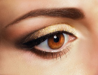 Women closeup with golden eye makeup