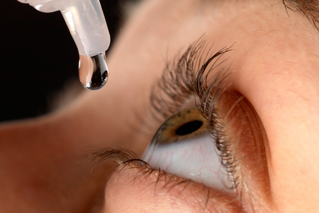 dropping artificial tears into the eye as a method on how to stop watery eyes