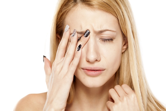 young woman with eye pain
