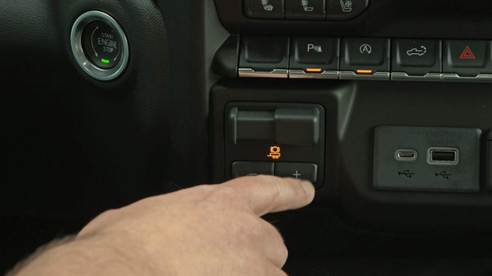 medium resolution of man pressing chevy silverado integrated trailer brake controller button