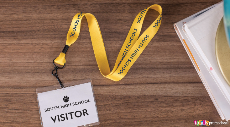School lanyard with visitor badge