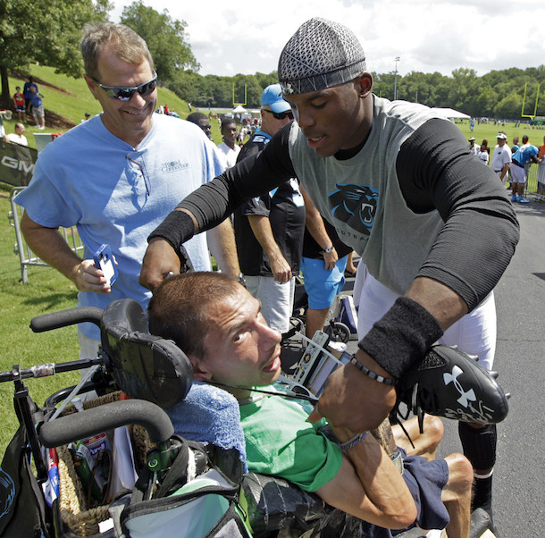 Cam Newton Gives Shoes Off His Feet to Fan in Wheel Chair