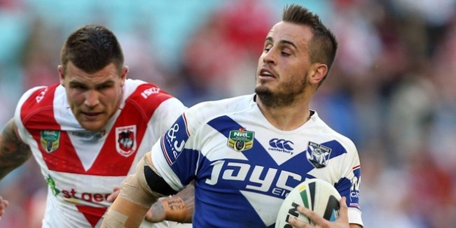 Josh Reynolds evades a tackle en route to scoring for Canterbury Bulldogs.