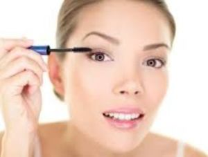 brushing makeup on