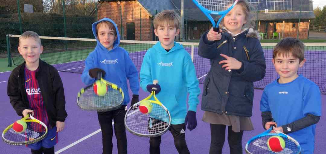 A group of children attending an organised coaching session in a safe and welcoming environment