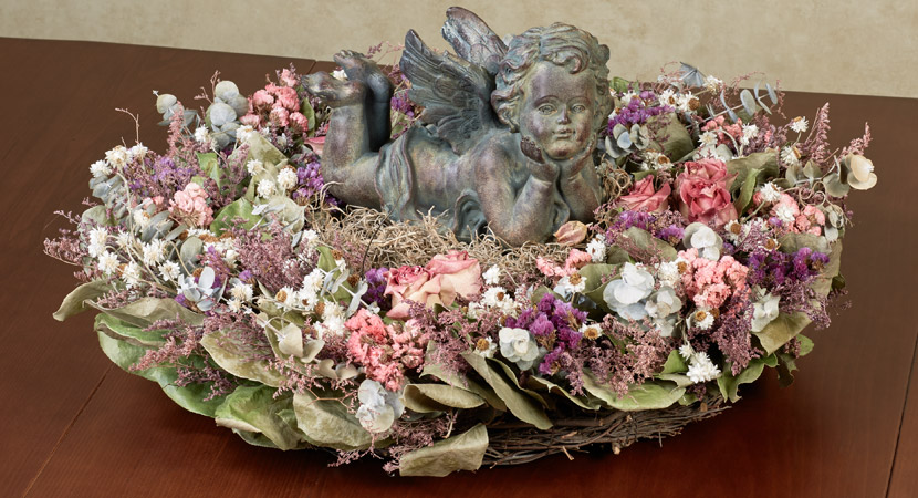 Cherub Laying in Floral Wreath