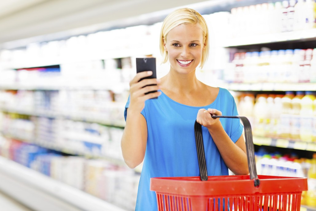 woman doing shopping with cell phone in hand