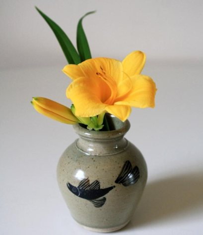pottery vase with fish design