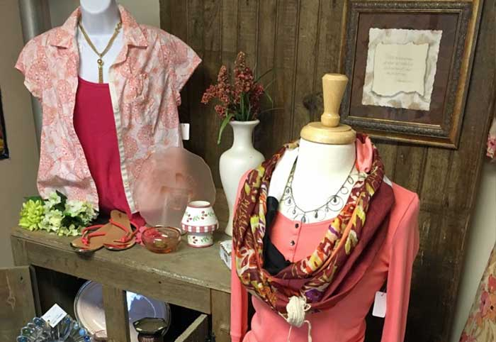 women's blouses and accessories on display at Second Street Thrift Store