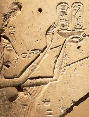 Nefertiti offers the early form of the Aten's cartouches to the divine sun disk