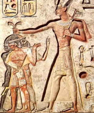 Ramesses II, armed with an axe, holds three foreign enemies by their hair. They include a Nubian, a Syrian and a Libyan.