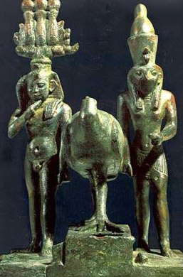 A bronze group with, on the left, the Child Horus wearing the Atef Crown, while on the right, Horus as king, wearing the Double Crown