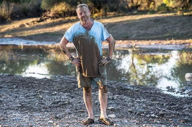 David Yarrow covered in mud