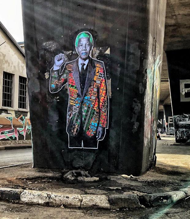 Graffiti of Nelson Mandela in Johannesburg by street artist ThePostmanArt