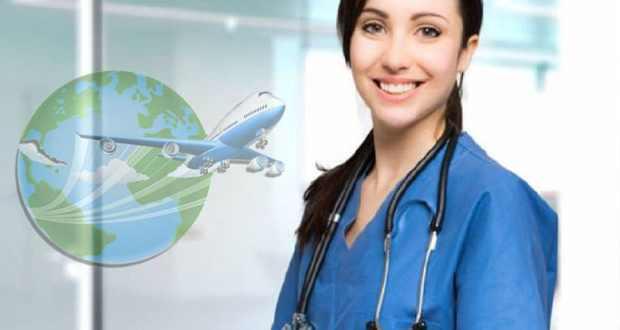 Nurse with travel globe in background